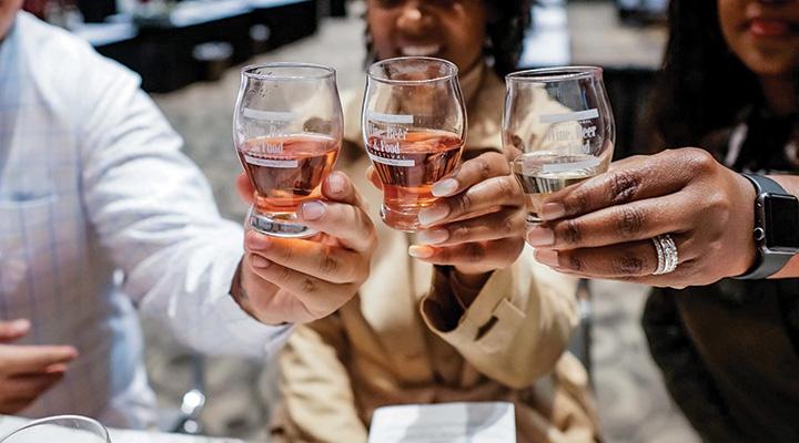 People cheers-ing at Grand Rapids International Wine, Beer and Food Festival